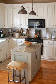 White cabinets, notice the scalloped wood detail under the microwave