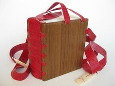 Early Coptic Codex. This book is sewn with a link stitch and has sewn endbands. The spine is covered with leather that laces into the wooden covers. Two long wrapping bands with bone closures are attached to the head and foredge. A large leather and vellum bookmark is attached to the back cover. This dramatic binding is based on the 4th century Glazier Codex in the collection of the Morgan Library in New York.