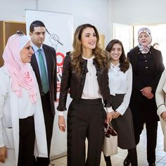 21 February 2017 - Queen Rania visits a school in Jordan - jacket by Alexander McQueen, shoes by Yves Saint Laurent, bag by Fendi