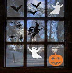 Halloween Fensterbilder aus Fledermäusen, Gespenstern, Spinnen, einer Hexe und einem Kürbis