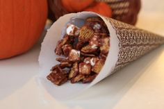 This year for Thanksgiving, I thought it would be fun to make some cornucopia cones for serving the S'more treats and popcorn.    To make a cone, all you need is a sheet of scrapbook paper, a pencil and string, scissors, glue or double stick tape and some parchment paper. A decorative scallop punch is optional, I'm using one for my cones. You could also use decorative scissors on the top.  To make a cone, draw a 1/4 circle. Do you remember the old compasses we used to use in school to make perfe