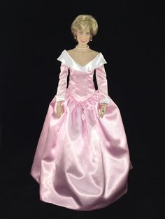 This Franklin Mint Diana doll is wearing a custom replica of a Catherine Walker pink gown for an official portrait with Prince Charles, taken by Lord Snowdon. It was also worn on a visit to Berlin in 1987 and to greet the President of Turkey the following year. Christie's auction 57