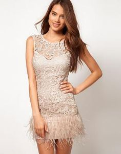 9fd7669c01 Feather trim dress by Lipsy VIP sold as ASOS. The delicate lace with a  floral design and feathers make it a unique party dress.