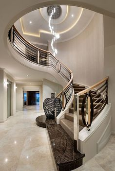 Luxury interiors luxury homes, curved staircase, grand staircase, stair rai Foyer Staircase, Curved Staircase, Staircases, Staircase Ideas, Luxury Staircase, Railing Design, Staircase Design, Foyer Design, Interior Stairs