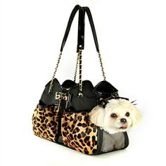 The Leopard Metro Couture Dog Purse is a gorgeous dog carrier that looks just like a designer purse with its chic leopard print design.
