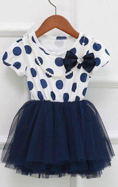 Polka dot dress with necklace from Little Diva Kids Boutique