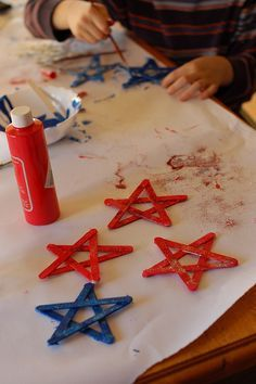 Painted craft stick stars with glitter - could do for 4th of July or Christmas