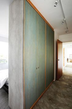 Using a wardrobe to act as a divider in the master bedroom