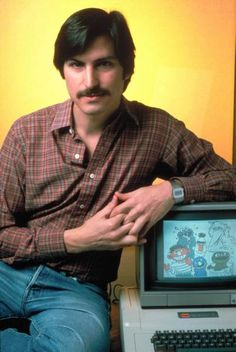 Apple co-founder Steve Jobs posing w. Apple II computer - LIFE