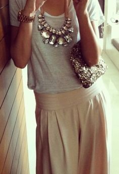 Statement necklace, sequin clutch, grey top and neutral skirt
