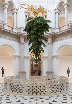 This Christmas tree installation focuses on the pine tree's natural qualities – such as its texture, colour, smell and shape – while also highlighting its roots in gold leaf.