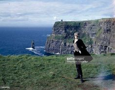 Model Nadja Auermann standing along the Irish Cliff's of Mocher with the…