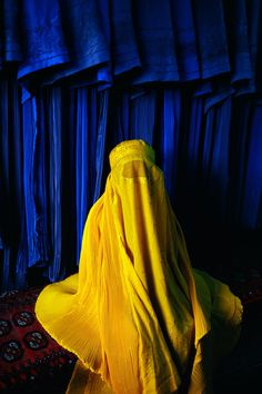 Bid now on Woman in Canary Burqa, Afghanistan by Steve McCurry. View a wide Variety of artworks by Steve McCurry, now available for sale on artnet Auctions. We Are The World, People Of The World, Mellow Yellow, Blue Yellow, Bright Yellow, Cobalt Blue, Blue Colors, National Geographic, Steve Mccurry Photos