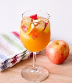 Caramel Apple Sangria - I would add another fruit or two (pear or orange?) and rim, the glass with cinnamon sugar!