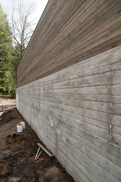 Board formed concrete wall & wood above