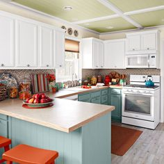 White kitchen with cabinet crown moulding - Saw this in Lowe's Creative Ideas Magazine! Amazing before and after and how they made their cabinets look brand new! I need to do this! Love the ceiling, too!