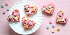 Chex mix and candy heart topped Rice Krispie treats w/pink frosting