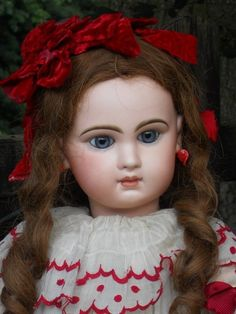 """Stunning wide - eyed Bebe with fine bisque and painting , original wig , body and beautiful clothing !!! She is a pretty size 12 Bebe ( 27"""" ( 69 cm ) by Emile Jumeau ..... circa 1888 in all perfect condition - bisque socket head with pretty blue glass paperweight inset eyes with dark eyeliner and fine long painted lashes."""