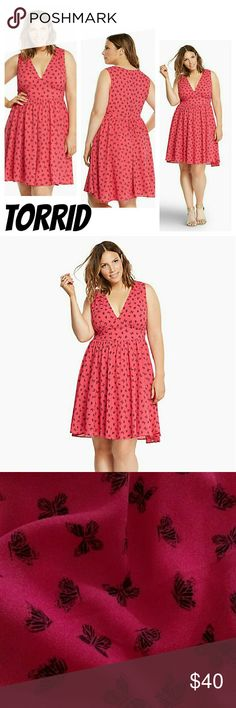 "Torrid Butterfly Print V-Neck Skater Dress 10 Float like a butterfly, sting like the sexy siren you are in this ""spotlight on me"" hot pink georgette dress. While the black butterfly print is all sweet, the gathered v-neck, seamed bust and slightly-flared skirt has the sex appeal turned up.    PolyesterWash cold, line dryImported plus size dress torrid Dresses"