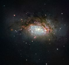 https://flic.kr/p/D3CxNa | Hubble Views a Galactic Mega-merger | The subject of this NASA/ESA Hubble Space Telescope image is known as NGC 3597. It is the product of a collision between two good-sized galaxies, and is slowly evolving to become a giant elliptical galaxy. This type of galaxy has grown more and more common as the universe has evolved, with initially small galaxies merging and progressively building up into larger galactic structures over time.  NGC 3597 is located…