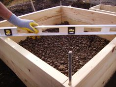 When installing your raised bed, check the level of the ground before driving the pins into place. Level beds hold moisture evenly and drain properly. To change the level of the bed  add soil, angled gravel, or decomposed granite sand under the boards corners to shim up a low side. The better this is done in the beginning the less likely a bed will become unlevel from shifting soil over time. But if it does, simply pry up a low side and fix it, or remove pins and redo if necessary.