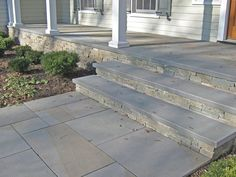 The stone veneer steps and front façade of the patio have been embellished with our Harbour Mist thin stone veneer. Natural stone treads and flagstone were . Front Porch Steps, Front Stairs, Front Walkway, House With Porch, House Front, Concrete Front Porch, Stone Porches, Building A Porch, Concrete Steps