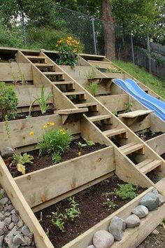 hillside planters with stairs going up to the top what a fantastic way of gardening in a backyard with a hillside slope