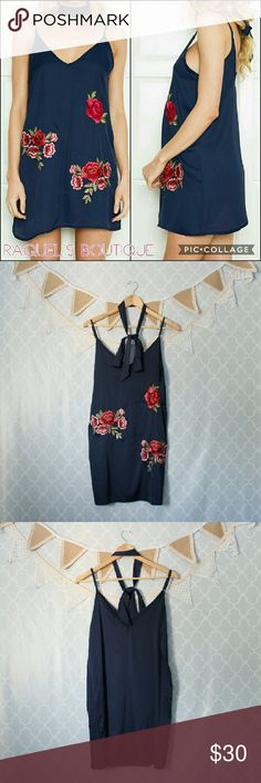 Navy Embroidered Slip Dress Details: Blue silky slip dress with rose embellishments in the front, adjustable straps and comes with matching long neckerchief/ choker   Brand: Boutique Brand   Size: Medium  Measurements: Bust/34 inches Length/28-32 inches   Size: Large  Measurements: Bust/36 inches Length/29-33 inches   Condition: New and packaged   Dresses Mini