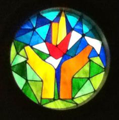 """The """"Hands-of-Peace"""" original stainglass window was presented to UU Peace Fellowship from the Raleigh UU Fellowship at the building dedication in April of 2011. Photo credited to the Unitarian Universalist Peace Fellowship."""