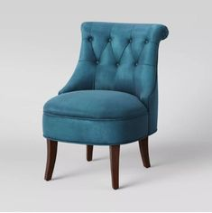 This armless accent chair features elegantly curved wood legs in a dark mahogany finish with a fully padded seat and button-tufted accents on the backrest - it's also covered with a velvet-like fabric to create a lively look. Boho Living Room, Living Room Chairs, Dining Chairs, Nursery Chairs, Arm Chairs, Upholstered Chairs, Blue Accent Chairs, Blue Velvet Chairs, Blue Chairs