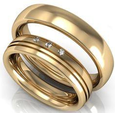 Alianzas de matrimonio en oro 18K con 3 diamantes.