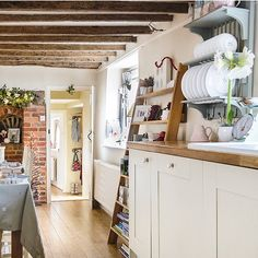 Cream country kitchen with plate rack