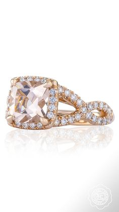 Two diamond scattered ribbon twisting bands unite as one at the crown of this gorgeous rose gold and pink diamond Tacori engagement ring.