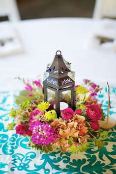 tea light candle lantern centerpiece (except I'd like fall colors, or something more leafy) :)