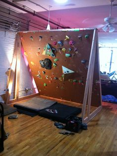 Imgur album of an indoor freestanding bouldering wall - Is there a reason why this couldn't be outdoor too?