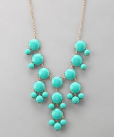 Stylishly unique, this contemporary necklace encourages elegant accessorizing. Bright bubble-shaped beads embellish the dramatic drape, satisfying any craving for color.27'' longAcrylic / resinMade in the USA