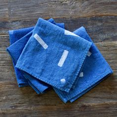 ABOUT This set of four sweet hand dyed indigo napkins is just the thing to spice up your dinner table. Super soft in a saturated medium blue, these charming square napkins are simple yet stylish. DETA
