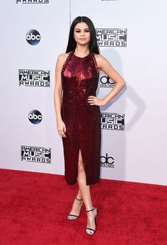 Selena Gomez wears a dark red Givenchy dress with ankle-strap heels