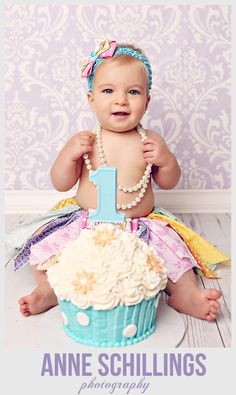Anne Schillings Photography Children's portrait photographer. Cake smash one year old girl cupcake pink teal turquoise tutu bow purple birthday baby balloon basket hot air studio