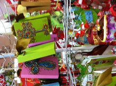 Crosses with puff paint? on wood and canvas. Colorful and gorgeous!