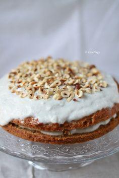 vegan pumpkin cake with coconut vanilla cream and roasted hazelnuts