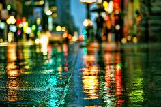 One of my favorite things about rain... I love the reflection of the lights on the street...