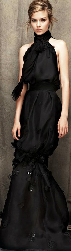 Nina Ricci... Give her black hair and we're in business.