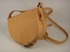 Leather Saddle Oval Bag ONLY 25 EUR! Buy Here: http://www.greek-sandals.com/Classic-Leather-Bags/Satchel---Saddle-Bags/499-Natural-Small-Saddle-Oval-Bag-Natural-Color/p-116-151-829/