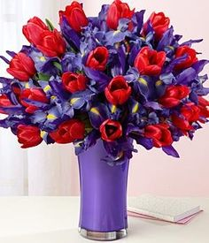 Flowers: Deluxe Hugs And Kisses - Our Deluxe Hugs And Kisses Bouquet Contains 20 Ruby Red Tulips And 20 Deep Blue Iris. One Of Our Most Popular B ...