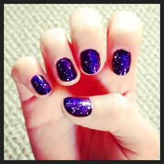 """My first attempt at a galaxy nail! I used a black base, with dark blue, pink and purple accents. I also used a silver glitter for the """"stars"""". I think for my next attempt I'll use a yellow accent color to add a lighter color to the """"galaxy""""."""