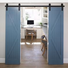 Barn doors leading into office, large plank wood floors, would change color of doors.