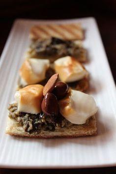 Crostini con crema di #melanzane e scamorza, #olive taggiasche e #mandorle