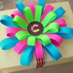 Need a gift topper? Grab some construction paper and a glue gun to make this simple bow.