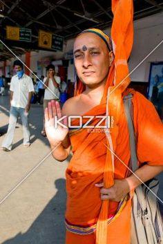 spiritual man - A spiritual man stands in an orange robe